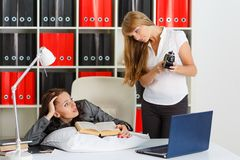 Tired businesswomen in the office. Royalty Free Stock Photo