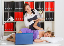 Tired businesswomen in the office. Royalty Free Stock Photos