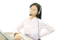 Tired call center operator Royalty Free Stock Photography