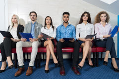 Tired Candidates Wait For Job Interview, Mix Race Business People Sitting In Line Human Resources Stock Image