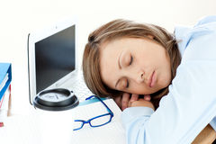 Tired caucasian businesswoman sleeping on her desk Stock Images