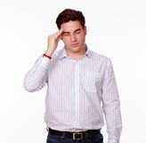 Tired caucasian man with headache standing Royalty Free Stock Images