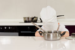 Tired chef laying head down on table Stock Image