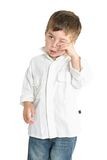 Tired Child. Tired young child rubbing his eyes Stock Images