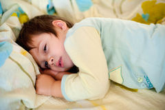 Tired child. Going to sleep soon Royalty Free Stock Image