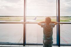 Tired child at the airport, traveling Stock Images