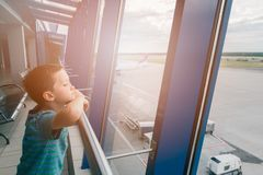 Tired child at the airport, traveling Royalty Free Stock Photos