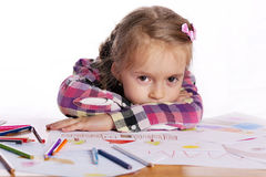 A tired child - an artist with a sketch. And colored pencils in a checkered shirt on a white background Royalty Free Stock Photos