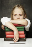 Tired child with books Stock Photos