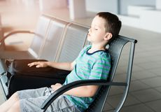 Tired child boy sleeping at the airport Royalty Free Stock Image