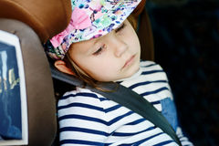 Tired child. Tired little girl in the car seat Royalty Free Stock Photos