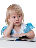 Tired child looking book Royalty Free Stock Photo