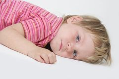 Tired child over white. Cute child over white background Stock Images