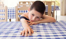 Tired child in restaurant royalty free stock photography