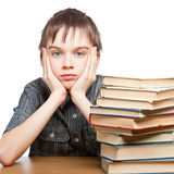 Tired child with stack of books Royalty Free Stock Photos