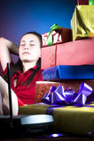 Tired Christmas office worker Royalty Free Stock Image