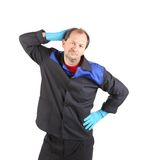 Tired cleaner man. Royalty Free Stock Photo
