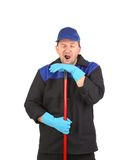 Tired cleaner with mop. Royalty Free Stock Images