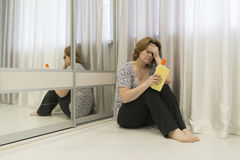 Tired of cleaning housewife sitting on  floor Stock Photo