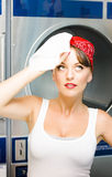 Tired Cleaning Lady. Brunette House Cleaning Lady Sighs In White Singlet While Wiping The Sweat From Her Brow With Damp Cleaning Cloth In Tired Cleaning Lady Royalty Free Stock Images