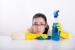 Tired cleaning lady on white Stock Images