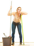 Tired cleaning woman mopping floor. Spring cleaning despair concept. Tired woman mopping floor. Girl upset and fed up about housework white background Royalty Free Stock Image