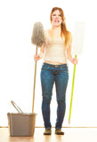 Tired cleaning woman mopping floor. Spring cleaning despair concept. Tired woman mopping floor. Girl upset and fed up about housework white background Royalty Free Stock Photos
