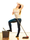 Tired cleaning woman mopping floor. Spring cleaning despair concept. Tired woman mopping floor. Girl upset and fed up about housework white background Stock Photos