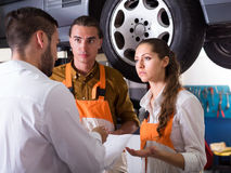 Tired client at auto service Stock Photo