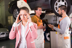 Tired client at auto service stock image
