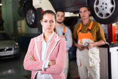 Tired client at auto service Royalty Free Stock Photo