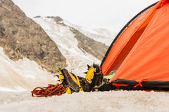 The tired climber has rest in tent with feet outside Royalty Free Stock Photography