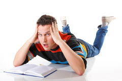 Tired college student after hard work for exam Stock Photography