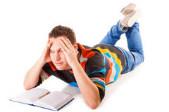 Tired college student preparing hard work for exam Royalty Free Stock Photo