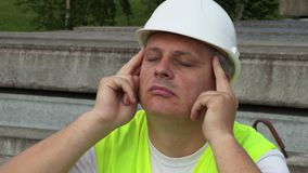Tired construction with painful head stock footage