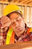 Tired Construction Worker Stock Photo
