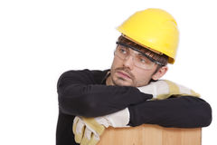 Tired construction worker. Isolated on white background Stock Photo