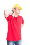 Tired construction worker feeling neck pain Stock Photography