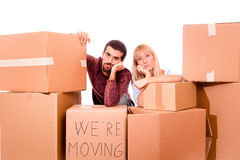 Tired Couple. Young Tired Couple on Moving royalty free stock photo