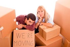 Tired Couple. Young Tired Couple on Moving stock photo