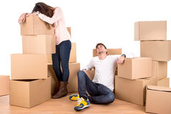 Tired couple with boxes Royalty Free Stock Images