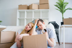 Tired couple with boxes. Moving into new home stock photos