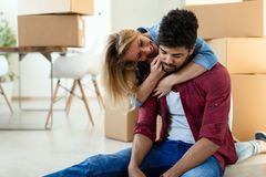 Tired couple with boxes moving into new home. Apartment royalty free stock photo