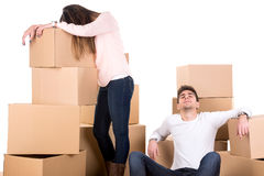 Tired couple with boxes. Moving into new home apartment Royalty Free Stock Image