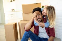 Tired couple with boxes moving into new home. Apartment stock images