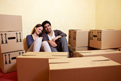 Tired couple sitting between many Stock Photography