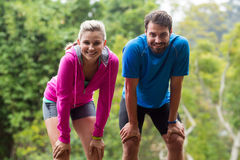Tired couple taking a break while jogging Stock Image