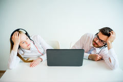 Tired customer service agents Royalty Free Stock Image