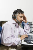 Tired Customer Service Operator On Call Royalty Free Stock Image