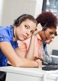 Tired Customer Service Representative In Office Stock Image